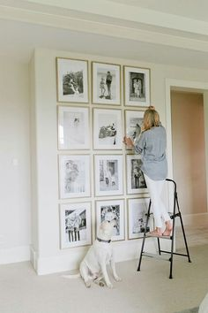 Black and white photos gallery wall in master bedroom
