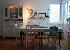 love the different chairs with vintage table