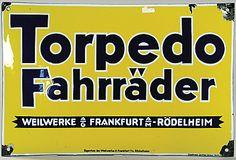 Automobilia Auktion Ladenburg Emaille-Schild 'Torpedo Fahrräder Weil Werke AG Frankfurt Rödelheim, Emaillewerk Gottfried Dichanz Berlin', 49 x 33 cm, gewölbt, Emailleschäden an den Ecken