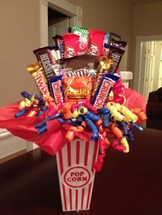Candy bouquet for the movies :) Candy Boquets, Candy Bar Bouquet, Gift Bouquet, Raffle Baskets, Gift Baskets, Movie Basket Gift, Movie Gift, Candy Arrangements, Sweet Trees