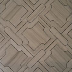 Castile Grande: A combination of waterjet cut stone with mosaic detailing � Contemporary and classic at the same time.