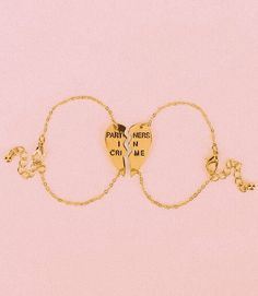 Jewels: partners in crime gold heart bff rose gold bracelets best friend bracelet urban outfitters Partners In Crime Bracelet, Jewelry Box, Jewelry Accessories, Jewellery, Bijou Box, Best Friend Bracelets, True Friends, Heart Of Gold, Friendship Bracelets