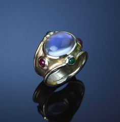 Rainbow moonstone in gold wide band ring with rubies and emeralds Gold Rings, Gemstone Rings, Custom Jewelry Design, Wide Band Rings, Rainbow Moonstone, Gold Jewelry, Emeralds, Blood Sugar, Gemstones