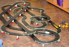 Ho-Scale slot car track presents hobbyists with a fun opportunity to have e Race Car Sets, Slot Car Race Track, Ho Slot Cars, Slot Car Racing, Slot Car Tracks, Race Tracks, Vintage Games, Vintage Toys, Food Trucks Near Me