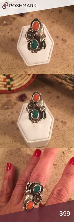 Vintage Coral & Turquoise Sterling Navajo ring 7.5 Authentic Vintage  Navajo Sterling Silver,Turquoise & Coral Ring size 7.5. This ring is in excellent vintage condition. The ring is right at 1 1/8 inches long and 3/4 of an inch wide. This piece has been tested and is Sterling Silver.  Please contact me with any questions. Jewelry Rings