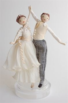 Halinka's Fairies--Wedding-Waltz..This charming wedding couple are dancing the waltz with joy. The girl has the palest blue dress and the man a blue neck tie and striped waist coat or they come in ivory colours They measure approximately 16cm from the bottom of the base to the top of the man's head.
