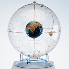"""Celestial Globe Learn About the Stars, Constellations, Sun and Planet Positions with this unique 12"""" transparent globe featuring an internal 4"""" Earth globe with adjustable Sun. Includes Study Guide. For grades 5-12."""