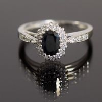 10k white gold ring with genuine diamonds and sapphires