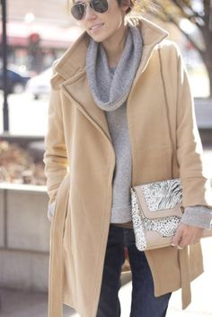 Winter coat and clutch over jeans and sweater