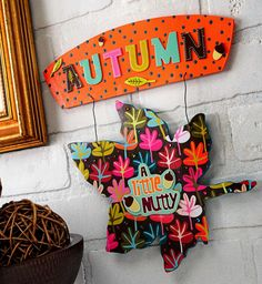 Dollar Tree has these wooden signs for every holiday...use your imagination & a few scraps & look what you can do!