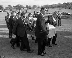 Bizarre turn: Reporters were enlisted to act as pall bearers for Lee Harvey Oswald's coffin in 1969 when no mourners turned up. Associated P...