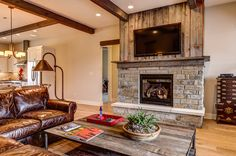Barn Wood Fireplace | Fireplace using reclaimed barn wood--and what to do on the sides?