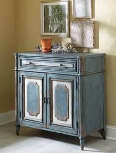 Antique, two-door table great for storage and as an accent piece. Blue and white worn finish gives the piece a warm, comfortable feel.