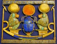 Famous Pharaohs: Pectoral of Tutankhamun Tutankhamun's Necklace with a Pectoral in the Form of a Solar Boat:  This pectoral is centered on a scarab of lapis lazuli, that symbolizes the god, Khepri.    Khepri represents the sun on the horizon of the new day. The scarab holds a solar disc of carnelian surrounded by a gold rim. The beetle is flanked by two baboons with lunar symbols on their heads.    This item was discovered inside an inlaid box of ebony and ivory with an inscription that…