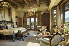 Master Suite, love the ceiling and windows. The Bed Crown with Draping is very luxurious.