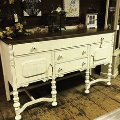 Old world beauty is painted in Annie Sloan's Old Ochre paint distressed with a newly restained top.  So many decorating possibilities with this gem!  Buffet is available at Under The Sun in Douglassville Pa.  #confessionsofafurniturehoarder #farmhouseliving #farmhousedesign #farmhousestyle #countrysideheirlooms #fleamarketlife #forsaleindouglassvillepa