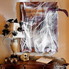 Dress up the front hallway for your fright night with faux spider webs, black ravens, and bats!