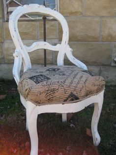 One of two victorian side chairs that I have painted and distressed and reupholstered in a French script burlap.  Headed to Texas for my booth at Graces Treasure Hunt in Carmine, Tx this Spring (2013).