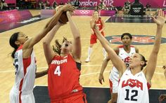 Canada's Krista Phillips (C) fights for a rebound with Candace Parker (L) and Diana Taurasi both of the U.S. in the women's quarterfinal basketball match at the Basketball Arena in London during the London 2012 Olympic Games August 7, 2012.
