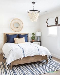 Guest Bedroom Spring Refresh Gorgeous spring coastal inspired guest bedroom with wood beaded chandelier, white bedding, navy blue throw pillows, round rattan mirror, and a gorgeous bedside table. Best White Paint, White Paint Colors, Paint Colors For Home, Gray Paint, Blue Bedroom Decor, Bedroom Paint Colors, White Bedroom, Bedroom Ideas, Master Bedroom