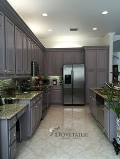 Refinished kitchen cabinet project using Chalk Paint® decorative paint by Annie Sloan. Color: Paloma by Dovetails llc, Naples, FL