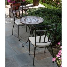 "Alfresco Home Tremiti Round Mosaic Bistro Set, 24-Inch by Alfresco Home. $499.00. Table: 24"" L x 24"" W x 29"" H; Chairs: 16"" L x 15.5"" W x 37"" H. Wrought Iron Frames are E-coated with a powder coat paint to provide a weather proof, rust resistant finish. Tiles are from natural sources including marble, slate and travertine. Marble Mosaic Bistro Table and Chairs with Cushion, Hand Set Marble Mosaic Tiles set in an Outdoor Industrial Adhesive Grout. Rust proof Stainless ..."