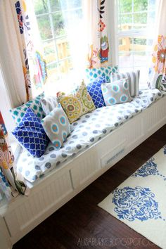Add extra seating to your living room with a DIY window seat! Get tips on this project from Alisa Burke of Redefine Creativity.  || @Alisa Bobzien Burke