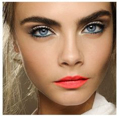 Love the colour combination -- the turquoise liner on the lower lash line and the bright coral lips are beautiful!