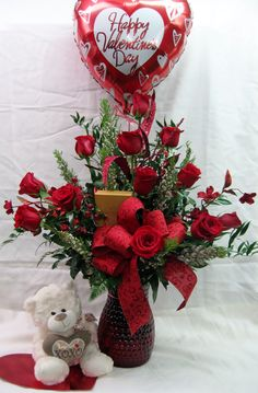 One dozen Gorgeous long stem red roses are designed in a lovely red glass vase topped off with a delicious box of Godiva chocolates, plush teddy bear and mylar balloon The Ultimate! Roses Valentines Day, Valentines Diy, Valentine Flower Arrangements, Floral Arrangements, Christmas Centerpieces, Valentine Decorations, Wax Flowers, Wedding Flowers, Red Glass