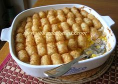 Cheesy tater tot casserole.....yum A southern staple at a pot luck.
