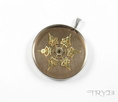 Steampunk handmade snowflake pendant of watch cogs. Background is made od copper.  See more on: http://tryb.com.pl #handmade #clockwork #pendant #tryb #jewelry #cogs #snow