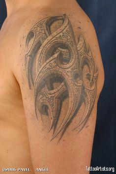 Pavel Angel stone tribal tattoo