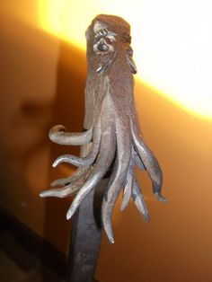 Cthulhu head fire poker blacksmith forged. by SouthSaxonForge