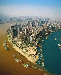 Confluence of the Jialing and Yangtze Rivers in Chongqing, China. One of my favorite places in China China Tourism, China Travel, Places Around The World, Around The Worlds, Great Places, Places To Visit, Chongqing China, Voyage New York, Two Rivers