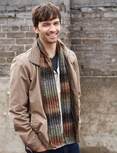 A simple stitch pattern and an attractive, earth tone variegated yarn collide to form the Hitchhiker's Scarf. This simple knit scarf pattern is a practical cold weather accessory for the man in your life. Mens Knitted Scarf, Knitted Hats, Men Scarf, Scarf Knit, Knitted Blankets, Knit Or Crochet, Crochet Scarves, Knitting Scarves, Knit Shawls