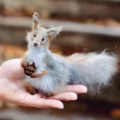 Squirrel hand-knitted from high-quality mohair yarn.  By Olga Mareeva - Squirrel with a pine cone.