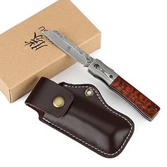 http://allknifelife.com/product/katsu-handmade-damascus-steel-japanese-razor-pocket-folding-knife-with-snake-wood-handle-and-damascus-bolster/