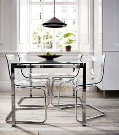 """""""I wanted to work with transparency as a predominate element in order to create furniture that gets its color and shape from the room it stands in. By combining glass and plastic with reflecting chrome, TOBIAS chair and TORSBY dining table become like an illusion, an abstract experience."""" Designer: Carl Öjerstam"""