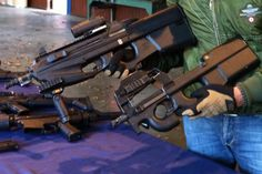 FNH: P2000 and P90. 5.56 x 45mm and 5.7 x 28mm. Belgian guns, as famous as their beer and chocolate.