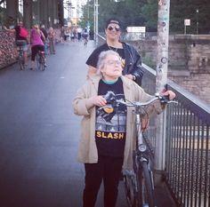 Slash photo bomb of nana rockin a Slash shirt in Germany. Photo credit Meegan Hodges via Slash Sydney and Slashandmeeganfans on Twitter/Instagram #Slash #MeeganHodges