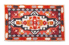 In a Lilliputian-city bathroom, a stylish bath mat can go a long way.
