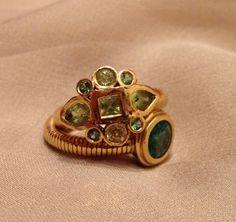 Anat Gelbard- handmade 22karat gold, emerald, peridot, rings
