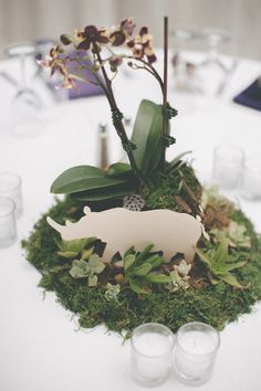animal-inspired centerpieces, photo by Evynn LeValley http://ruffledblog.com/henry-miller-library-wedding #rhino #reception