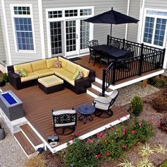Trex transcends decking, steel framing and custom aluminum railing with fire pit.