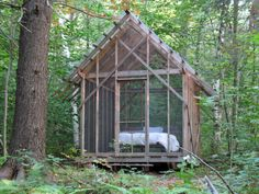 I love this idea for a wooded getaway on the land for summer.  It also seems like the perfect way to make a permanent screen tent closer to the house.