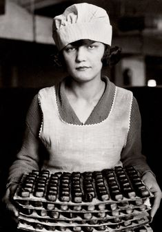 Lewis Hine  Candy Worker, New York  1925.  Think today, the workers have to wear hair nets and gloves......
