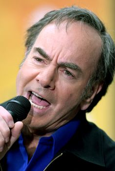 """Neil Diamond's family temporarily relocated to Cheyenne, Wyoming, during his father's military service in World War II. During their time in Wyoming, Neil fell in love with """"singing cowboy"""" movies on matinée showings at the local cinema. Diamond Songs, Diamond Music, Neal Diamond, Diamond Girl, Famous Aquarians, Father Images, The Jazz Singer, Barenaked Ladies, Diamonds"""