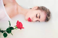 An attractive young woman lies in milk bath holding a red rose by Jovana Rikalo - Stocksy United Milk Bath Photography, Photography Women, Boudoir Photography, Make Up Inspiration, Photoshoot Inspiration, Milk Bath Photos, Fotografia Tutorial, Floral Bath, Bath Girls