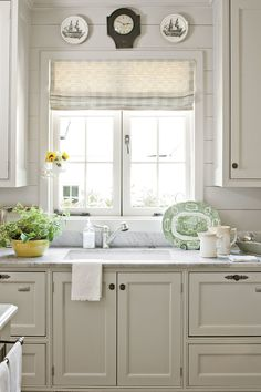Push-out casement windows and panked walls add to the kitchen's vintage feel.