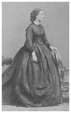 Charlotte of Belgium standing in crinoline day dress by Disdéri. Crinoline day dresses where very much like the evening dresses except somewhat more casual to wear in the day.